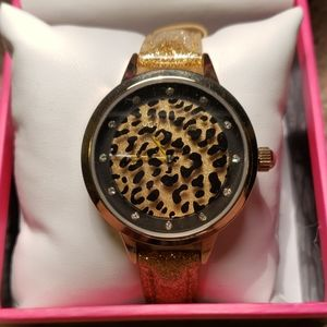 Betsey Johnson round & round leopard gold watch